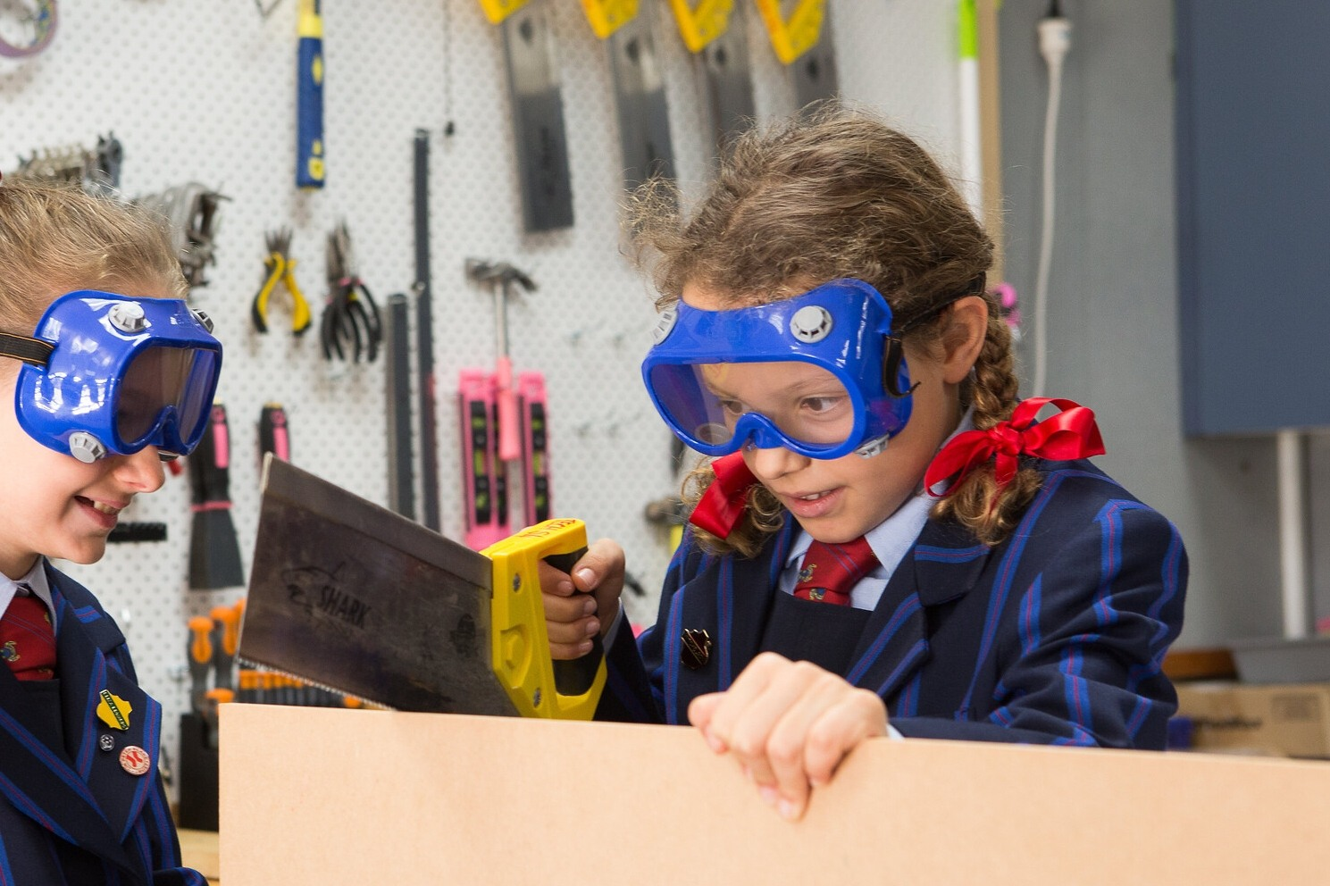 The Junior school MakerSpace work area presents readily available materials and items with which to invent